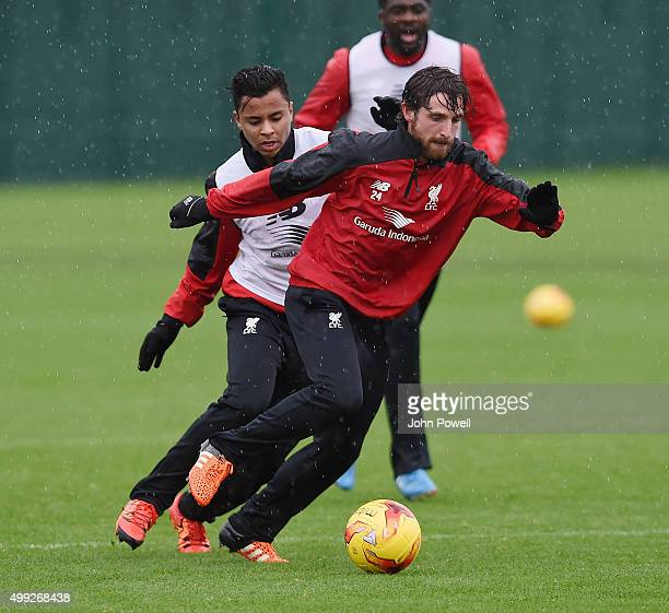 Joe Allen and Allan Rodrigues de Souza of Liverpool during a training session at Melwood Training Ground on November 30 2015 in Liverpool England