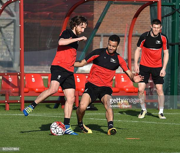 Joe Allen and Kevin Stewart of Liverpool during a training session at Melwood Training Ground on April 19, 2016 in Liverpool, England.