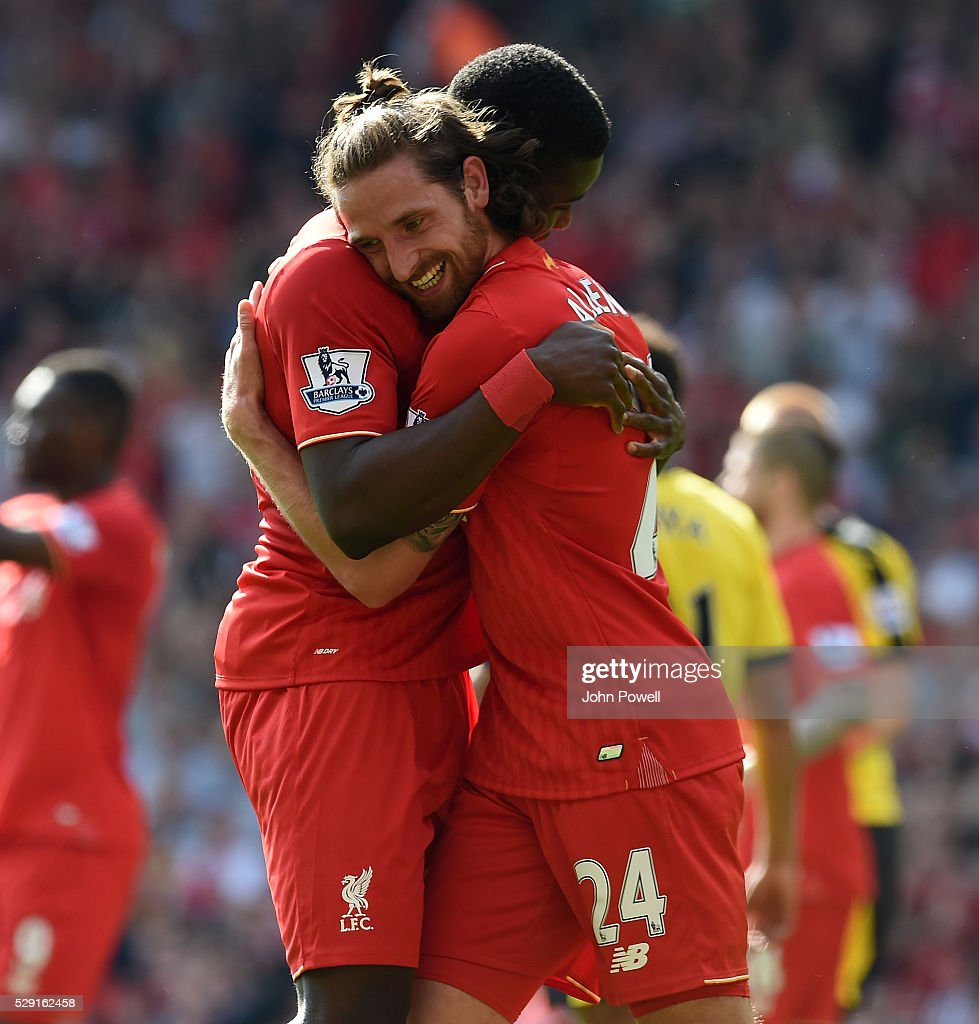 Joe Allen celebrates of Liverpool his goal with Sheyi Ojo of Liverpool during the Barclays Premier League match between Liverpool and Watford at Anfield on May 08, 2016 in Liverpool, England.