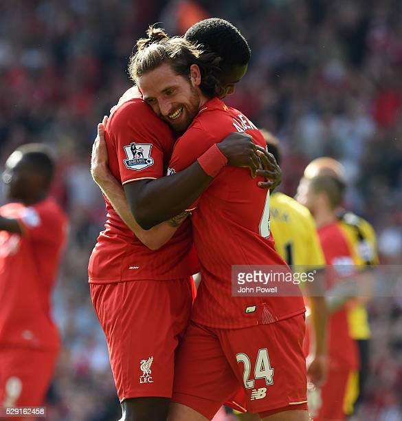 Joe Allen celebrates of Liverpool his goal with Sheyi Ojo of Liverpool during the Barclays Premier League match between Liverpool and Watford at...