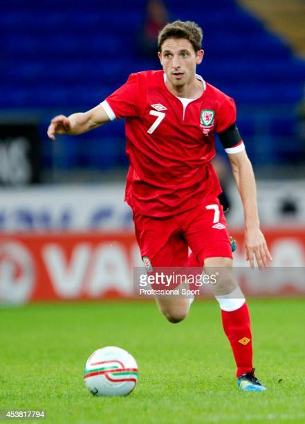 Joe Allen in action for Wales during the Wales v Norway International Friendly match at the Cardiff City Stadium on November 12 2011 in Cardiff Wales