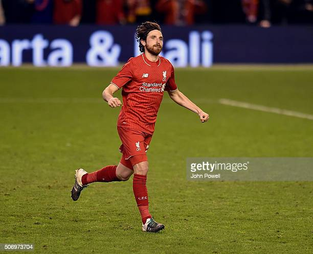 Joe Allen of Liverpool celebrates after scoring the winning penalty during the Capital One Cup Semi Final Second Leg between Liverpool and Stoke City...