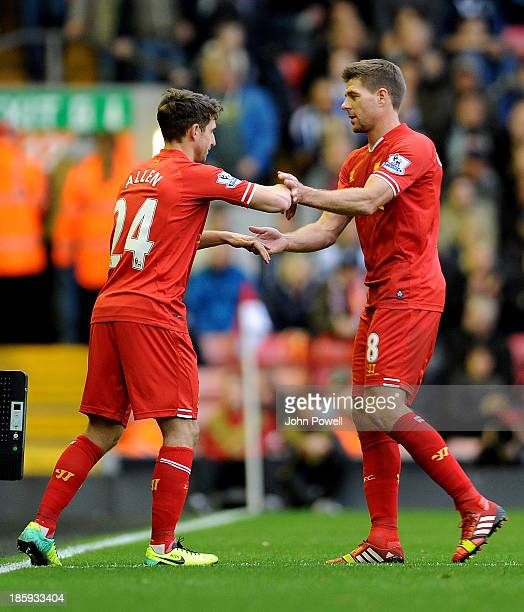 Joe Allen of Liverpool comes on for Steven Gerrard of Liverpool during the Barclays Premier League match between Liverpool and West Bromwich Albion...