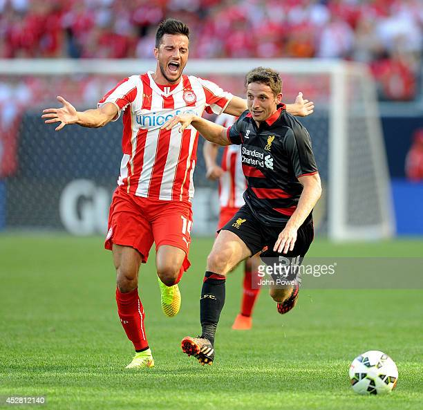 Joe Allen of Liverpool competes with Andreas Samaris of Olympiacosduring the International Champions Cup match between Liverpool and Olympiacos at...
