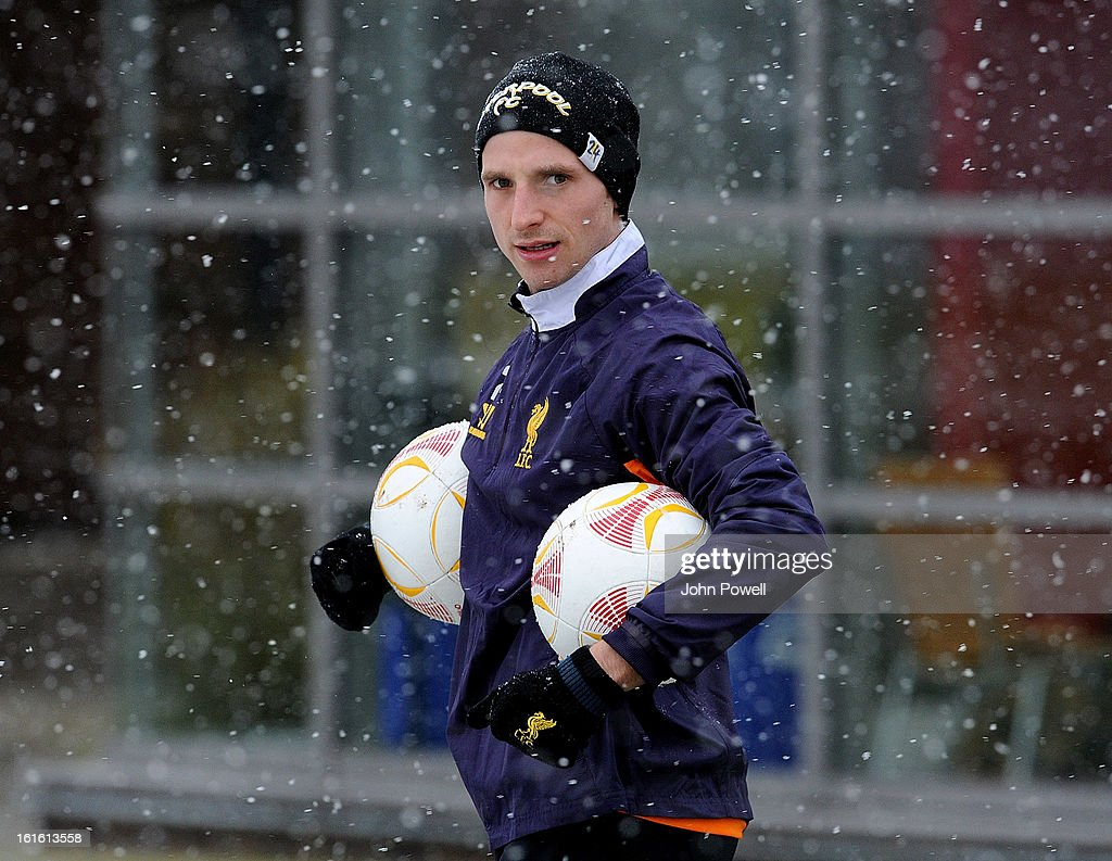 Joe Allen of Liverpool in action during a training session at Melwood Training Ground on February 13, 2013 in Liverpool, England.