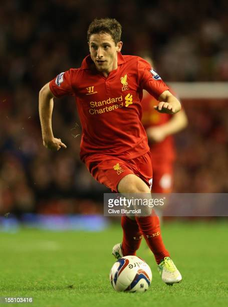 Joe Allen of Liverpool in action during the Capital One Cup Fourth Round match between Liverpool and Swansea City at Anfield on October 31 2012 in...