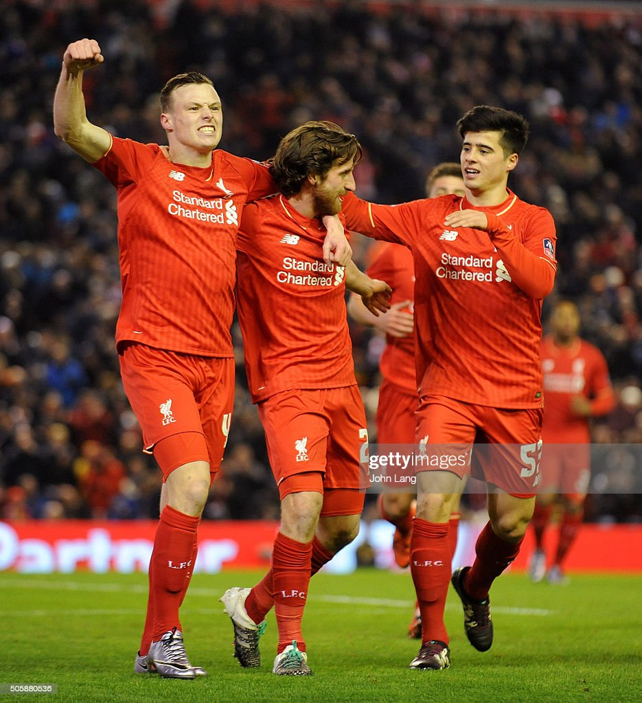 Joe Allen of Liverpool is congratulated after his goal during The Emirates FA Cup Third Round Replay between Liverpool and Exeter City at Anfield on January 20, 2016 in Liverpool, England.