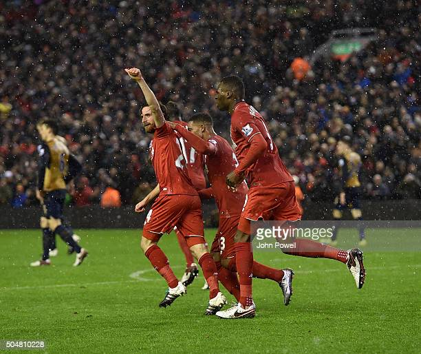 Joe Allen of Liverpool is congratulated after his goal to make it 33 during the Barclays Premier League match between Liverpool and Arsenal at...
