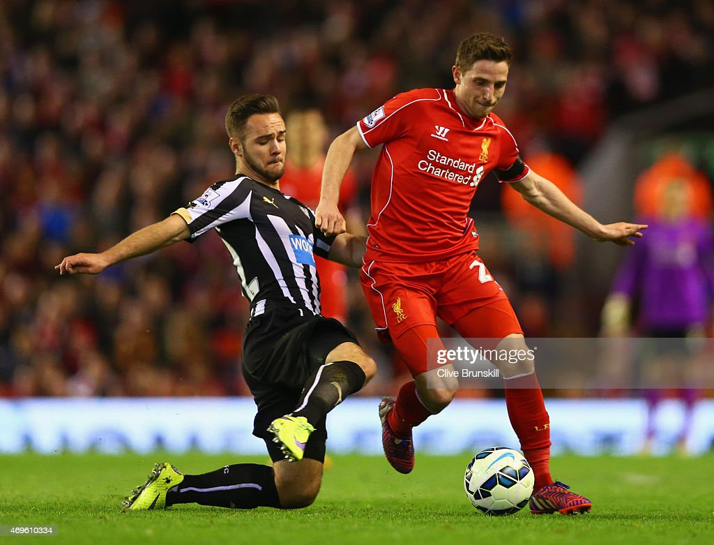 Joe Allen of Liverpool is tackled by Adam Armstrong of Newcastle United during the Barclays Premier League match between Liverpool and Newcastle United at Anfield on April 13, 2015 in Liverpool, England.