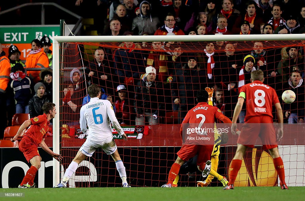 Joe Allen (L) of Liverpool scores his team's second goal during the UEFA Europa League round of 32 second leg match between Liverpool FC and FC Zenit St Petersburg at Anfield on February 21, 2013 in Liverpool, England.