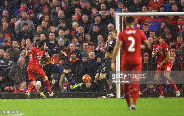 Joe Allen of Liverpool scores his team's third goal during the Barclays Premier League match between Liverpool and Arsenal at Anfield on January 13...