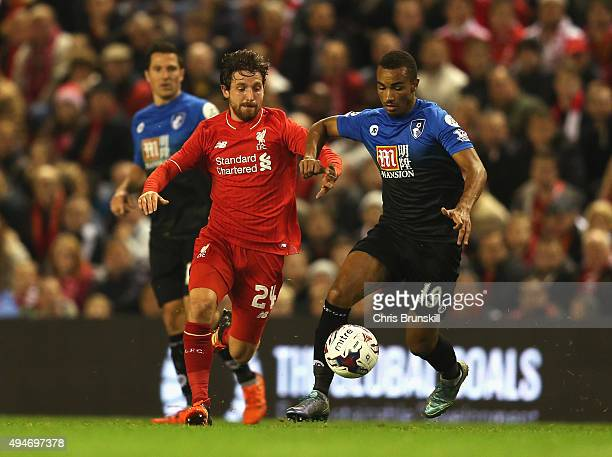 Joe Allen of Liverpool takes on Junior Stanislas of Bournemouth during the Capital One Cup Fourth Round match between Liverpool and AFC Bournemouth...