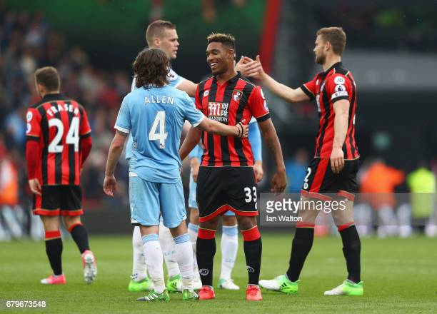 Joe Allen of Stoke City and Jordan Ibe of AFC Bournemouth speak after during the Premier League match between AFC Bournemouth and Stoke City at the...