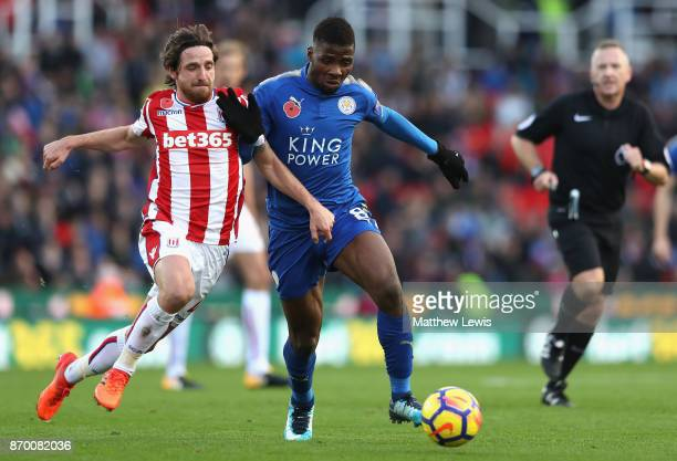 Joe Allen of Stoke City and Kelechi Iheanacho of Leicester City battle for possession during the Premier League match between Stoke City and...