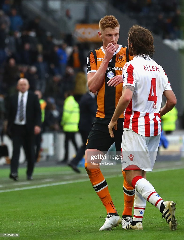 Joe Allen of Stoke City and Sam Clucas of Hull City square off after the final whistle of the Premier League match between Hull City and Stoke City at KCom Stadium on October 22, 2016 in Hull, England.