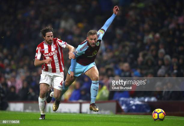 Joe Allen of Stoke City and Scott Arfield of Burnley in action during the Premier League match between Burnley and Stoke City at Turf Moor on...