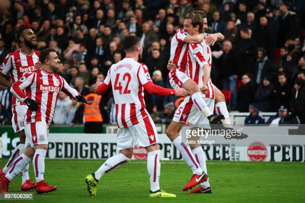 Joe Allen of Stoke City celebrates after scoring his sides first goal with Peter Crouch of Stoke City during the Premier League match between Stoke...