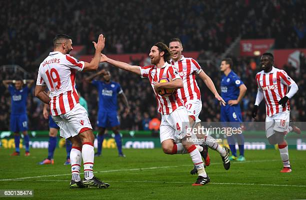 Joe Allen of Stoke City celebrates scoring his sides second goal with Jonathan Walters of Stoke City during the Premier League match between Stoke...