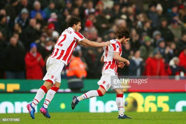 Joe Allen of Stoke City celebrates scoring the opening goal with his team mate Ramadan Sobhi during the Premier League match between Stoke City and...