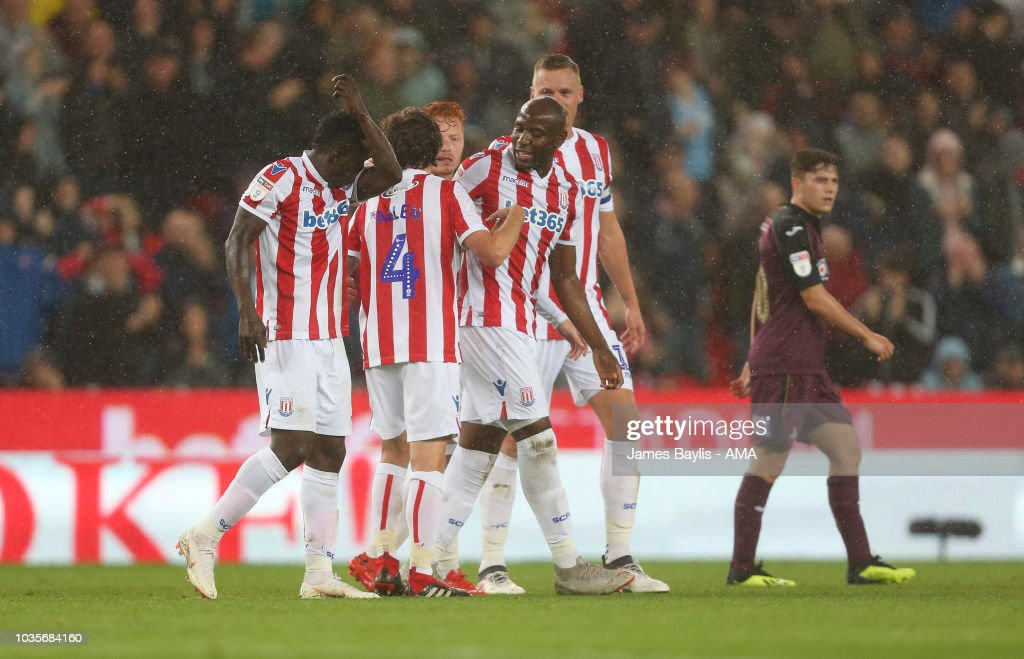 Joe Allen of Stoke City celebrates with his team mates after scoring a goal to make it 1-0 during the Sky Bet Championship match between Stoke City and Swansea City at Bet365 Stadium on September 18, 2018 in Stoke on Trent, England.
