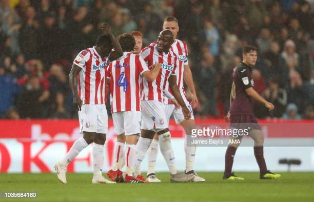 Joe Allen of Stoke City celebrates with his team mates after scoring a goal to make it 10 during the Sky Bet Championship match between Stoke City...