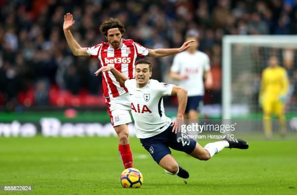 Joe Allen of Stoke City fouls Harry Winks of Tottenham Hotspur during the Premier League match between Tottenham Hotspur and Stoke City at Wembley...