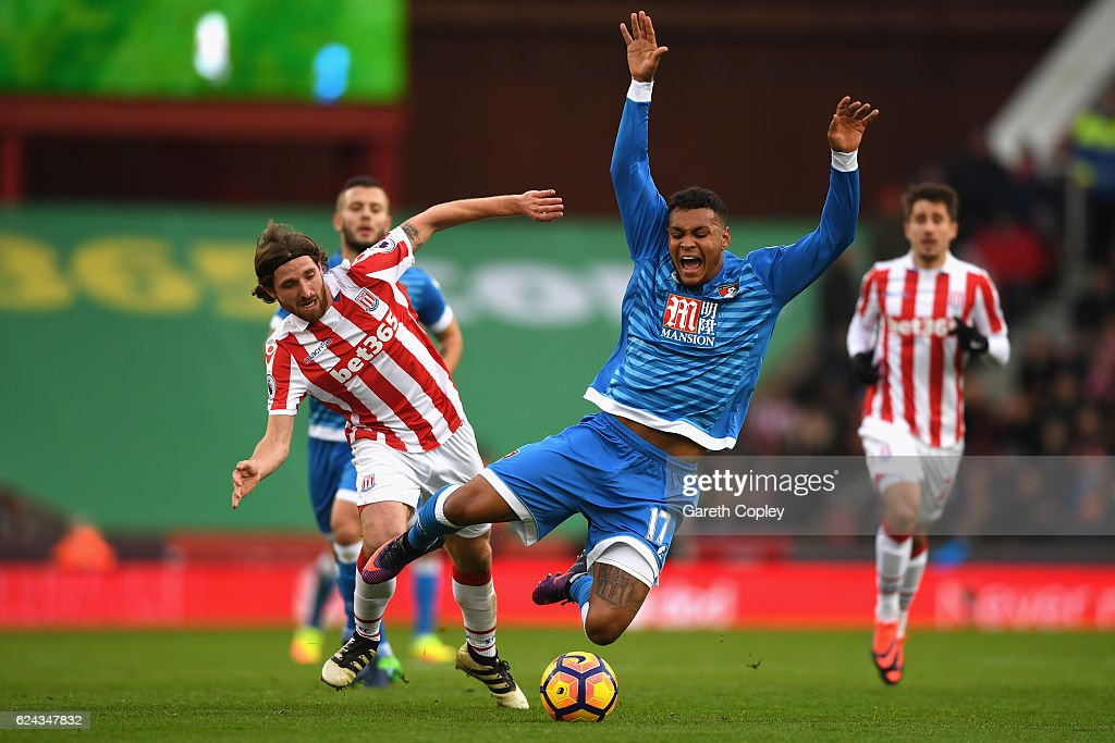 Joe Allen of Stoke City (L) fouls Joshua King of AFC Bournemouth (R) during the Premier League match between Stoke City and AFC Bournemouth at Bet365 Stadium on November 19, 2016 in Stoke on Trent, England.