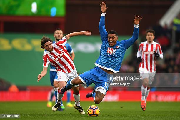 Joe Allen of Stoke City fouls Joshua King of AFC Bournemouth during the Premier League match between Stoke City and AFC Bournemouth at Bet365 Stadium...