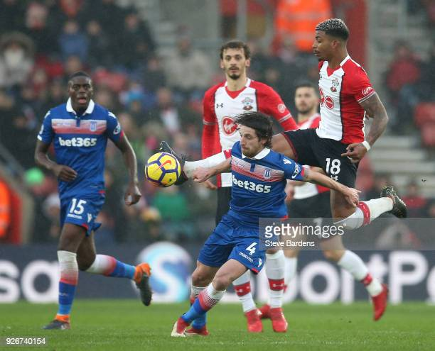 Joe Allen of Stoke City is challenged by Mario Lemina of Southampton during the Premier League match between Southampton and Stoke City at St Mary's...