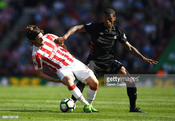 Joe Allen of Stoke City is fouled by Joel Matip of Liverpool during the Premier League match between Stoke City and Liverpool at Bet365 Stadium on...