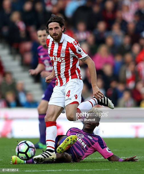 Joe Allen of Stoke City is tackled by Dider Ndong of Sunderland during the Premier League match between Stoke City and Sunderland at Bet365 Stadium...