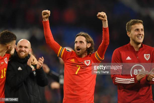Joe Allen of Wales celebrates after the final whistle during the UEFA Euro 2020 qualifier between Wales and Hungary so at Cardiff City Stadium on...