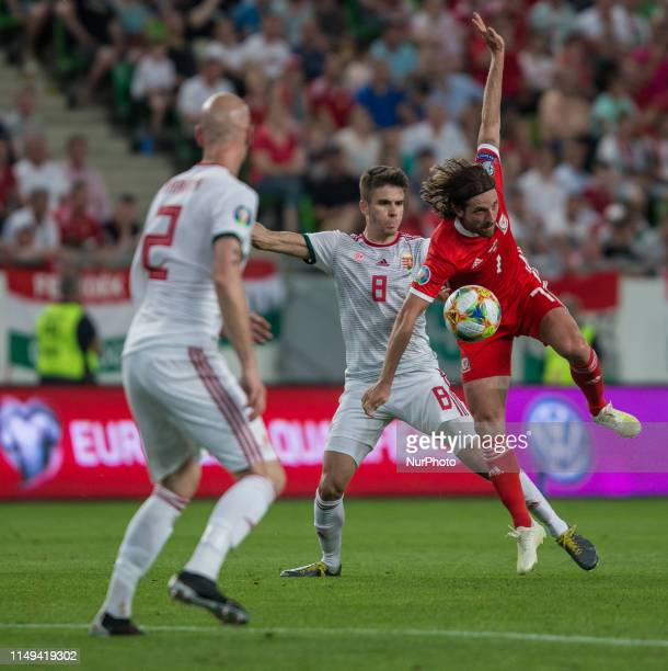 Joe Allen of Wales competes for the ball with Adam Nagy of Hungary during the Hungary and Wales European Qualifier match at Groupama stadium on June...