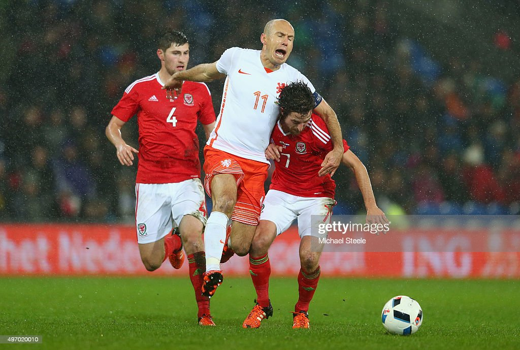 Joe Allen of Wales is challenged by Arjen Robben of Netherlands during the international friendly match between Wales and Netherlands at Cardiff City Stadium on November 13, 2015 in Cardiff, Wales.