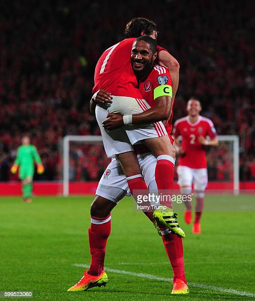 Joe Allen of Wales is lifted in the air by Ashley Williams of Wales as he celebrates after scoring his sides second goal during the 2018 FIFA World...
