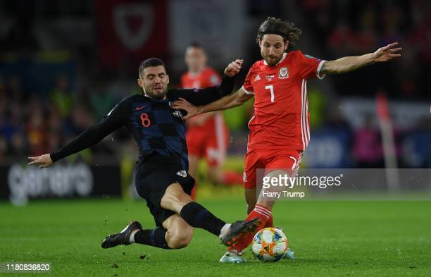 Joe Allen of Wales is tackled by Mateo Kovacic of Croatia during the UEFA Euro 2020 qualifier between Wales and Croatia at Cardiff City Stadium on...