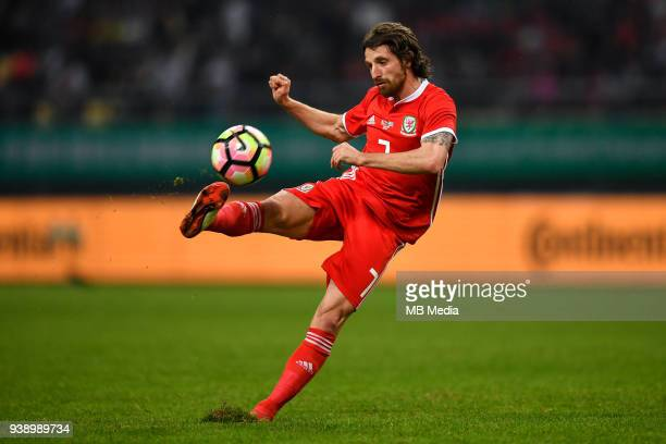 Joe Allen of Wales national football team kicks the ball to make a shoot against Uruguay national football team in their final match during the 2018...