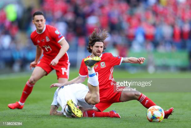 Joe Allen of Wales tackles Juraj Kucka of Slovakia during the 2020 UEFA European Championships group E qualifying match between Wales and Slovakia at...