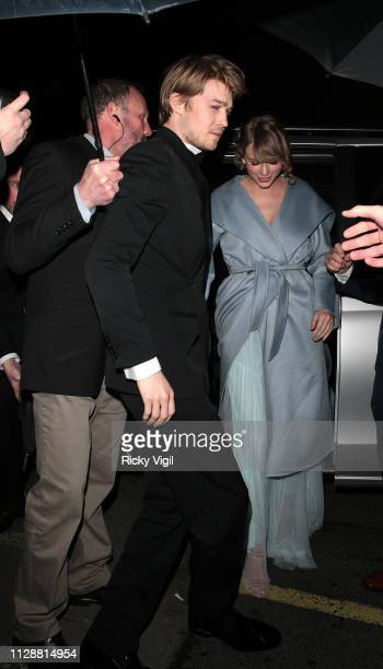 Joe Alwyn and Taylor Swift seen at the BAFTAs Vogue x Tiffany Fashion Film afterparty at Annabel's on February 10 2019 in London England