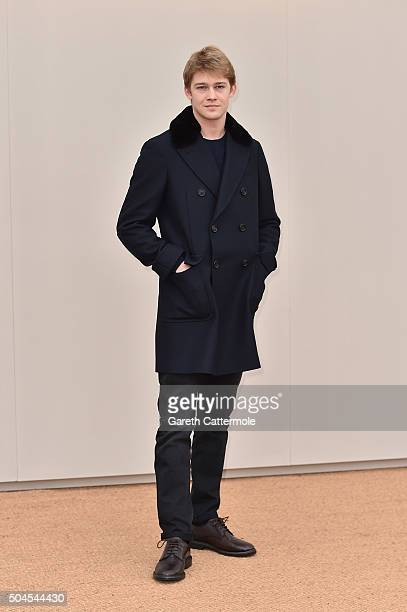 Joe Alwyn wearing Burberry attends the Burberry Menswear January 2016 Show on January 11 2016 in London United Kingdom
