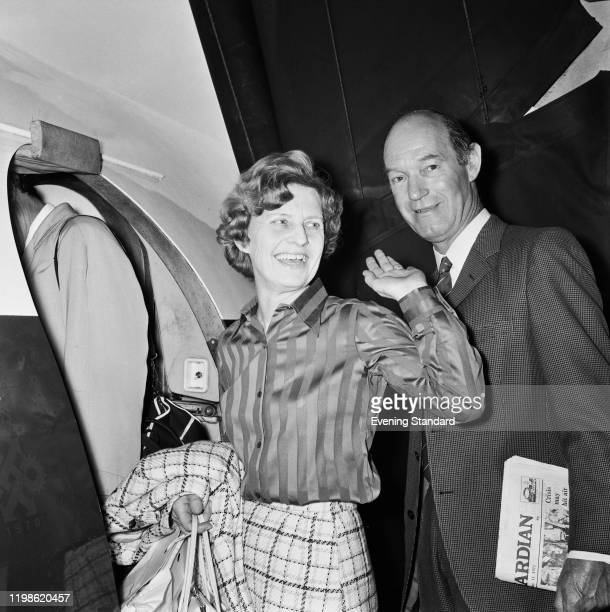 Joe and Eva Jagger the parents of Mick Jagger of the Rolling Stones prepare to board a flight to France to attend the wedding of their son and his...