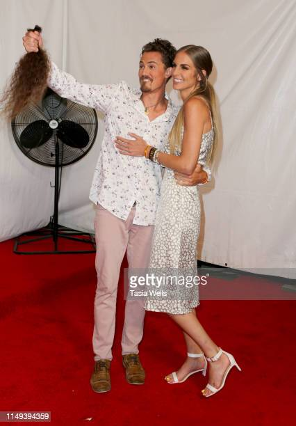 """Joe Anglim, after cutting his hair, and fiance Sierra Dawn Thomas attend the Red Carpet Event for CBS' """"Survivor"""" Finale at CBS Studio Center on May..."""