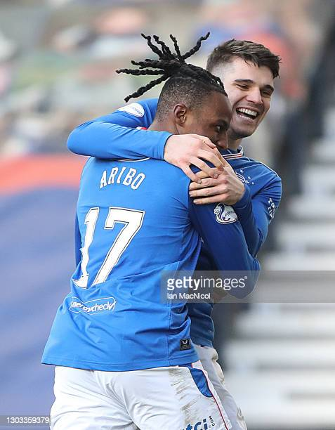 Joe Aribo of Ranger celebrates with Ianis Hagi of Rangers after he scores his sides third goal during the Ladbrokes Scottish Premier League match...