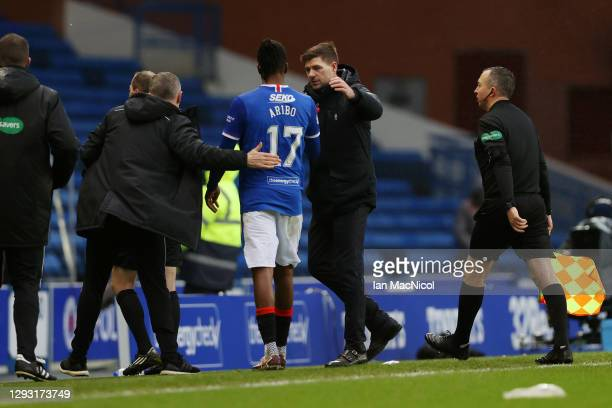 Joe Aribo of Rangers is greeted by Steven Gerrard, Manager of Rangers following the Ladbrokes Scottish Premiership match between Rangers and...