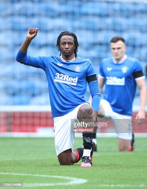 Joe Aribo of Rangers takes the knee during the pre season friendly match between Rangers and Coventry City at Ibrox Stadium on July 25 2020 in...