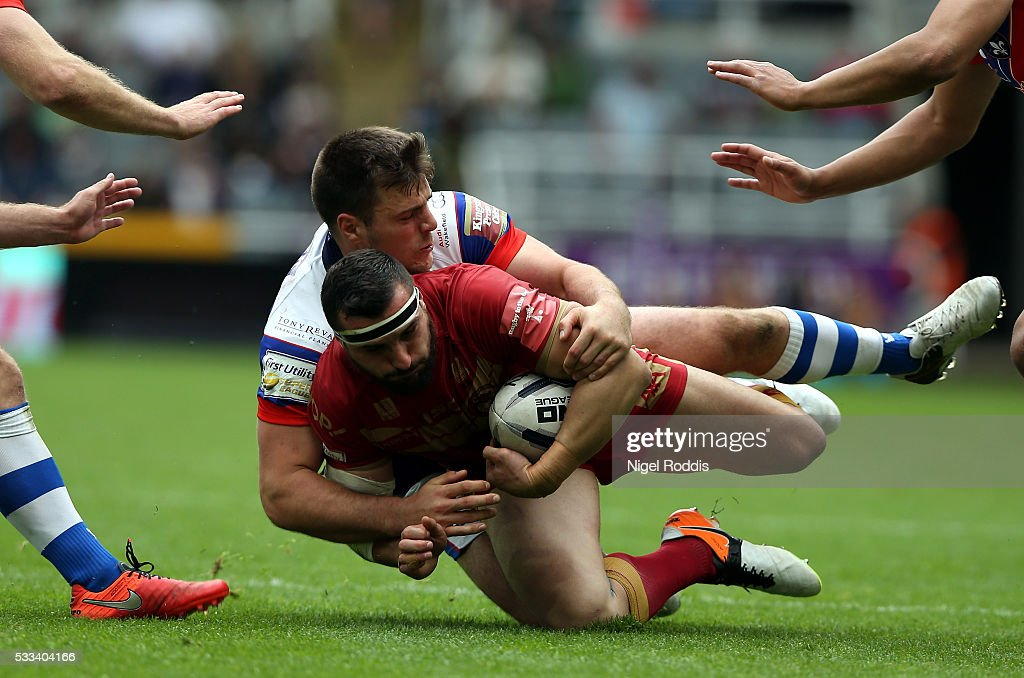 Joe Arundel of Wakefield Wildcats (L) tackles Vincent Duport of Catalans Dragons during the First Utility Super League match between Wakefield Wildcats and Catalans Dragons at St James' Park on May 22, 2016 in Newcastle upon Tyne, England.