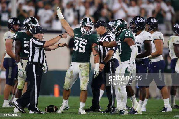 Joe Bachie of the Michigan State Spartans celebrates a late fourth quarter interception while playing the Utah State Aggies at Spartan Stadium on...