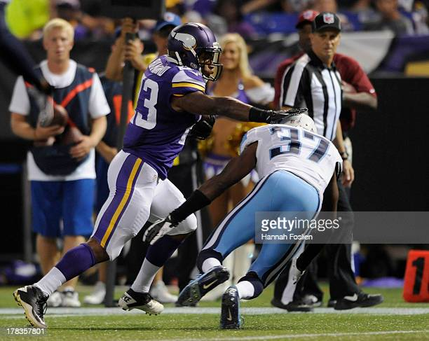 Joe Banyard of the Minnesota Vikings avoids a tackle by Tommie Campbell of the Tennessee Titans during the second quarter of the game on August 29...