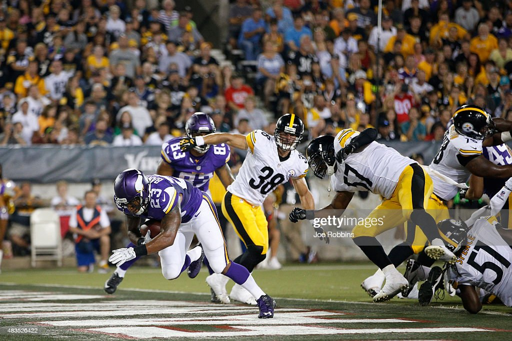 Joe Banyard #23 of the Minnesota Vikings rushes for a one-yard touchdown against the Pittsburgh Steelers in the third quarter of the NFL Hall of Fame Game at Tom Benson Hall of Fame Stadium on August 9, 2015 in Canton, Ohio.