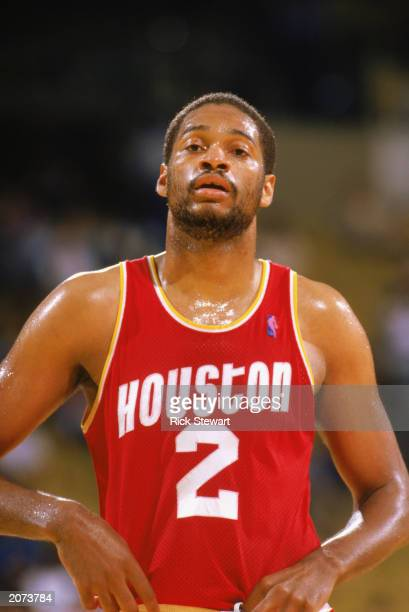 Joe Barry Carroll of the Houston Rockets waits on court during a game in the198788 season NOTE TO USER User expressly acknowledges and agrees that by...